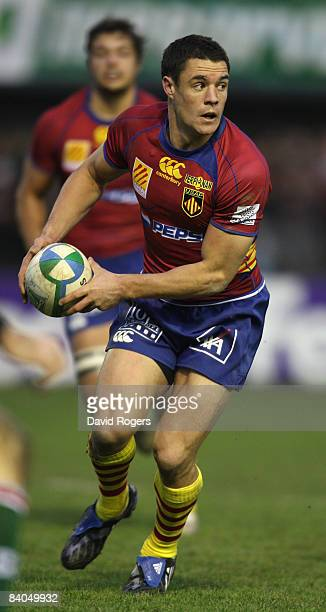 Dan Carter of Perpignan runs with the ball during the Heineken Cup match between Perpignan and Leicester Tigers at Stade Aime Giral on December 14...