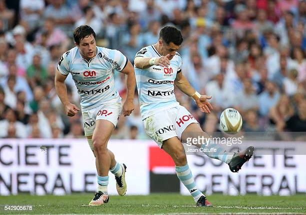 Dan Carter of Racing 92 in action while Henry Chavancy looks on during the Final Top 14 between Toulon and Racing 92 at Camp Nou on June 24 2016 in...