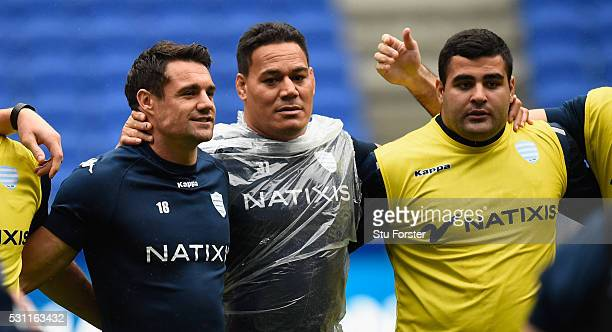 Dan Carter of Racing shares a joke with team mates during the Racing 92 Captain's Run ahead of the European Rugby Champions Cup Final against...