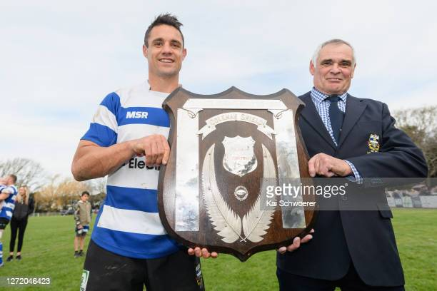 Dan Carter of Southbridge and his father Neville Carter pose with the Coleman Shield after winning the Ellesmere Division 1 Final between Southbridge...