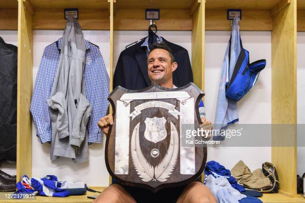 Dan Carter of Southbridge celebrates with the Coleman Shield in the dressing room after winning the Ellesmere Division 1 Final between Southbridge...