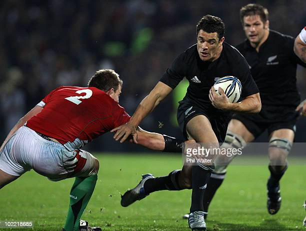 Dan Carter of the All Blacks breaks the tackle of Matthew Rees of Wales to score a try during the First Test match between the New Zealand All Blacks...