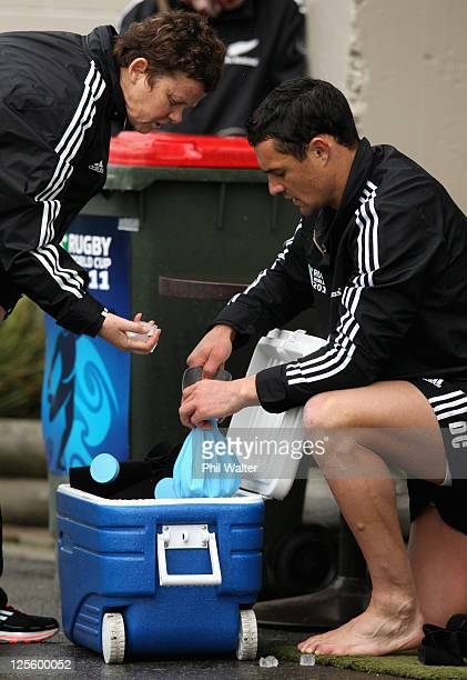 Dan Carter of the All Blacks fills up an icepack with help from Doctor Deb Robinson during a New Zealand All Blacks IRB Rugby World Cup 2011 training...