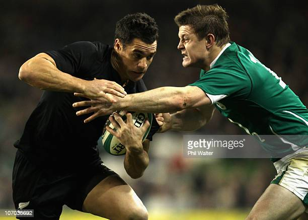 Dan Carter of the All Blacks is tackled by Brian O'Driscoll of Ireland during the Test match between Ireland and the New Zealand All Blacks at Aviva...