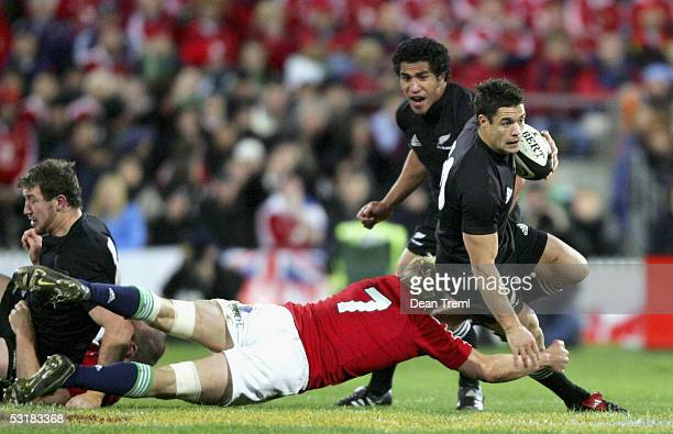 Dan Carter of the All Blacks is tackled by Lewis Moody of the Lions during the second test between the British and Irish Lions and the New Zealand...