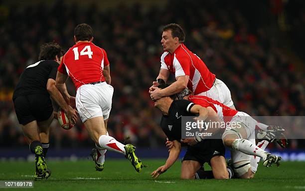 Dan Carter of the All Blacks is tackled by Wales captain Matthew Rees during the Test match between Wales and the New Zealand All Blacks at...