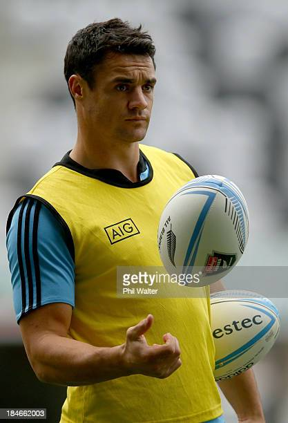 Dan Carter of the All Blacks juggles a ball during a New Zealand All Blacks training session at the Forsyth Barr Stadium on October 15, 2013 in...