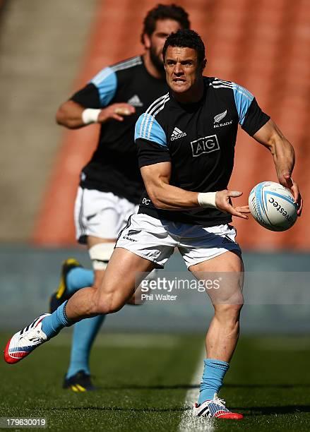 Dan Carter of the All Blacks passes during a New Zealand All Blacks Captain's Run at Waikato Stadium on September 6 2013 in Hamilton New Zealand