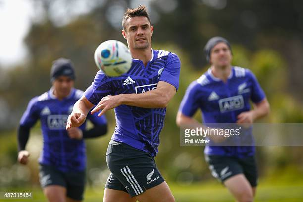 Dan Carter of the All Blacks passes during a New Zealand All Blacks training session at Trusts Stadium on September 9, 2015 in Auckland, New Zealand.