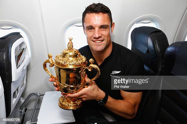 Dan Carter of the All Blacks poses with the Webb Ellis Cup enroute to Christchurch for the New Zealand All Blacks welcome home celebrations on...