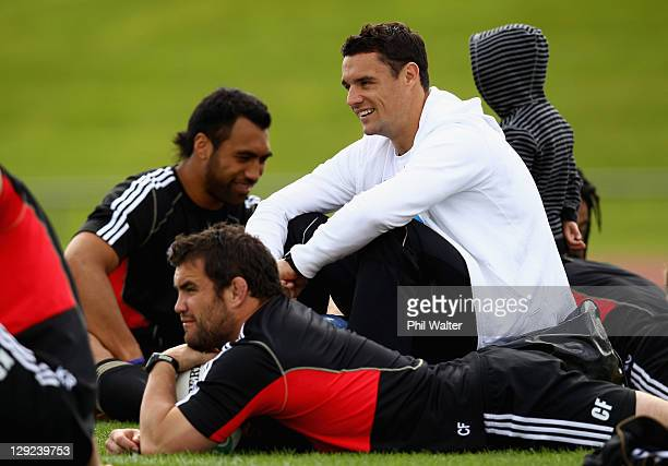 Dan Carter of the All Blacks relaxes with Victor Vito and Corey Flynn during a New Zealand All Blacks IRB Rugby World Cup 2011 captain's run at...