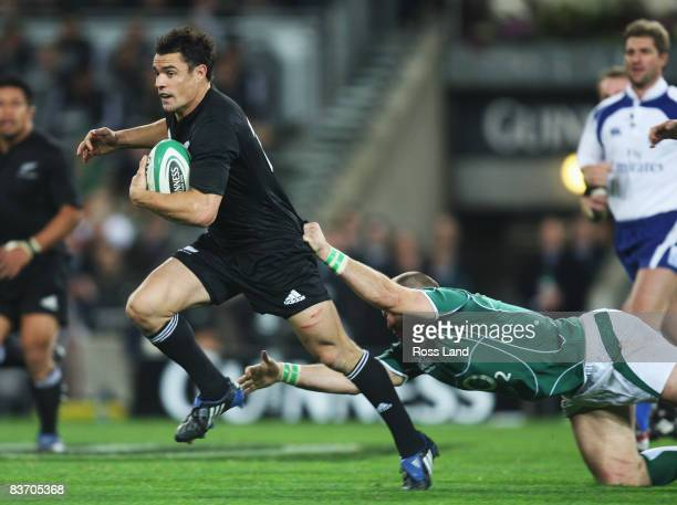 Dan Carter of the All Blacks runs through the tackle of Rory Best during the Guinness Series match between Ireland and New Zealand at Croke Park on...