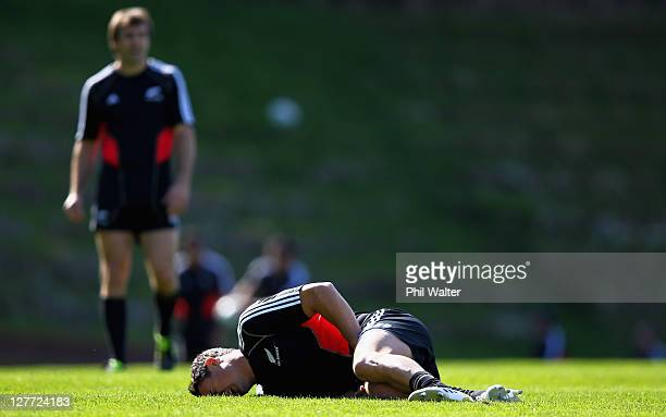 Dan Carter of the All Blacks shows the pain of a groin injury suffered during a New Zealand All Blacks IRB Rugby World Cup 2011 captain's run at...