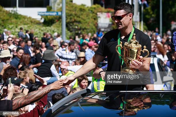 Dan Carter of the All Blacks with the Webb Ellis Cup as the team heads towards Hagley Park during the New Zealand All Blacks welcome home...