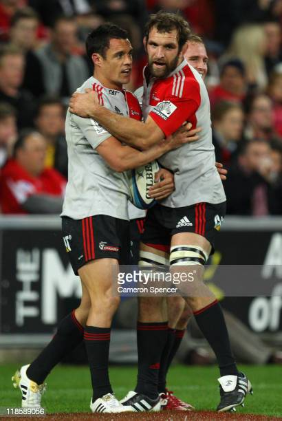 Dan Carter of the Crusaders is congratulated by team mate George Whitelock after scoring a try during the 2011 Super Rugby Grand Final match between...
