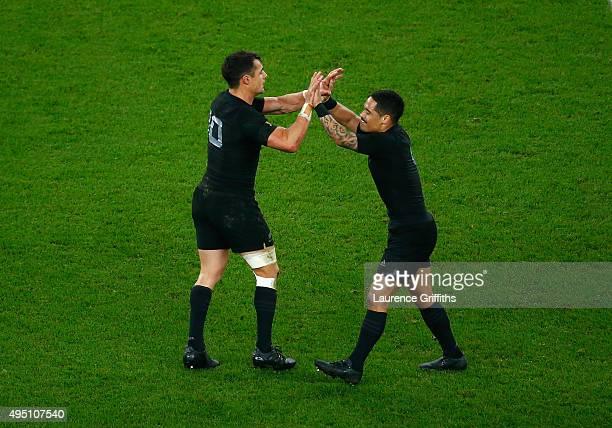 Dan Carter of the New Zealand All Blacks celebrates with Aaron Smith of the New Zealand All Blacks after his drop goal puts his side 2417 ahead...