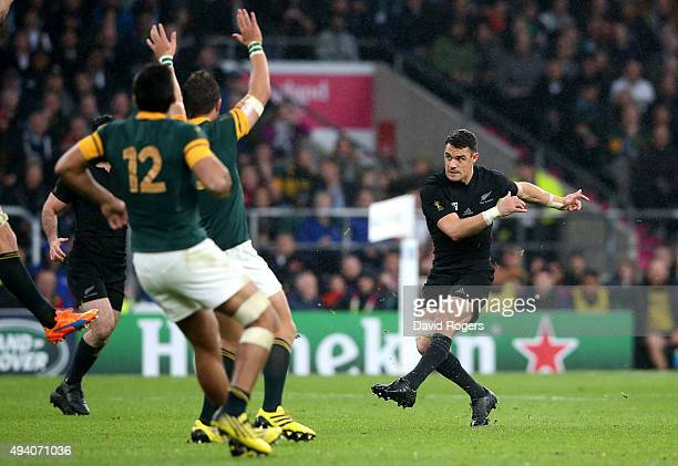 Dan Carter of the New Zealand All Blacks kicks a drop goal during the 2015 Rugby World Cup Semi Final match between South Africa and New Zealand at...