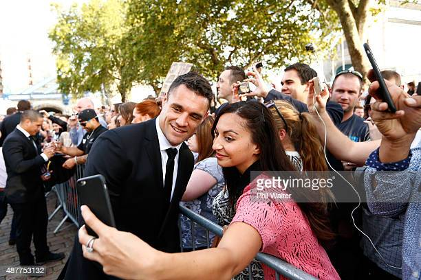 Dan Carter of the New Zealand All Blacks meets with fans following their RWC 2015 Welcome Ceremony at the Tower of London on September 11, 2015 in...