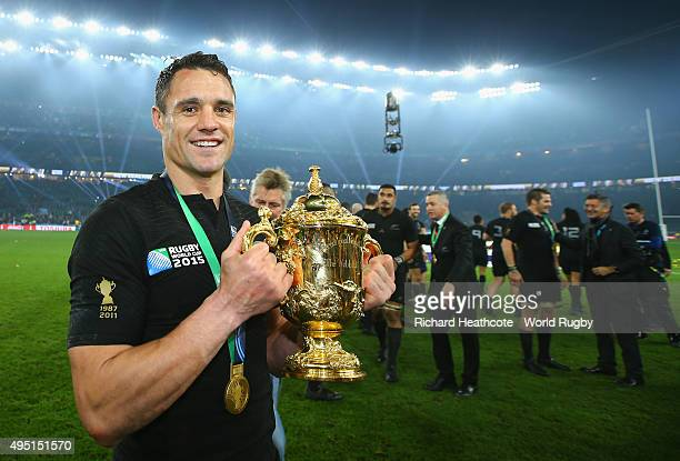Dan Carter of the New Zealand All Blacks poses with the Webb Ellis Cup following the victory against Australia in the 2015 Rugby World Cup Final...
