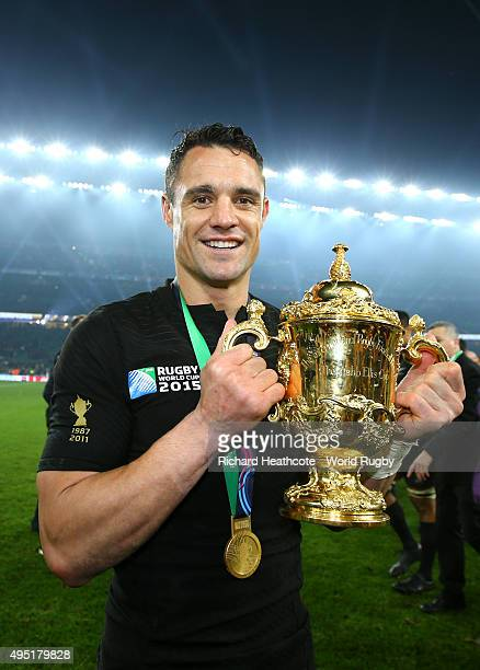 Dan Carter of the New Zealand All Blacks poses with the Webb Ellis Cup after victory in the 2015 Rugby World Cup Final match between New Zealand and...