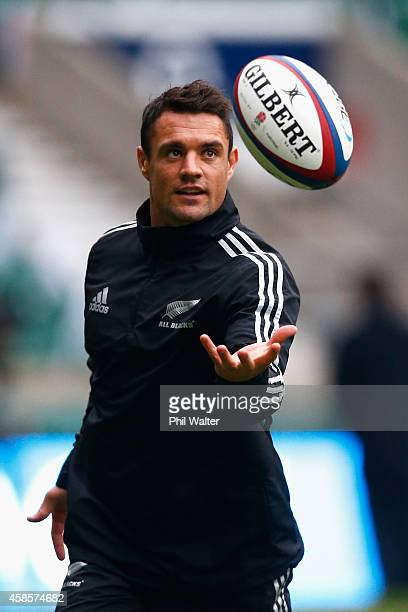 Dan Carter of the New Zealand All Blacks takes a catch during a kicking practice session at Twickenham Stadium on November 7 2014 in London England