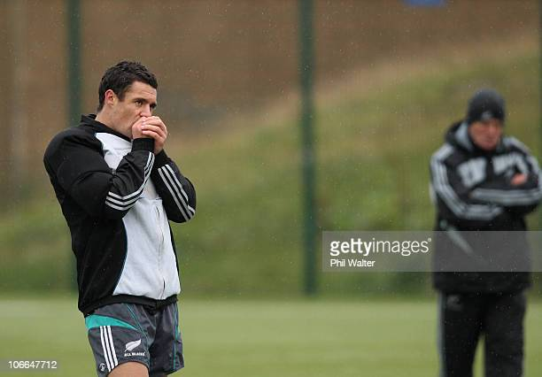 Dan Carter of the New Zealand All Blacks warms his hands at a training session at the Spartans Community Football Academy on November 9 2010 in...