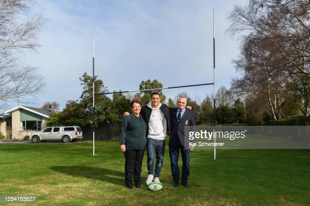 Dan Carter poses with his father Neville and his mother Bev in front of his first goalposts at the family home prior to the Ellesmere Premier...