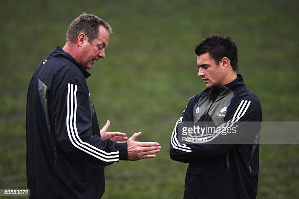 Dan Carter talks with skills coah Mick Byrne during a New Zealand All Blacks training session held at Perffermill fields November 06, 2008 in...