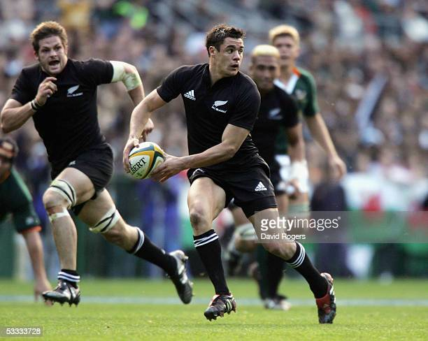 Dan Carter the All Black standoff moves away with the ball during the TriNations international rugby match between South Africa and New Zealand at...