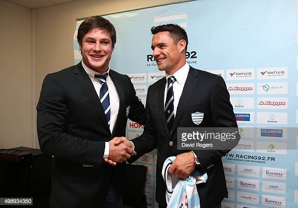 Dan Carter the former New Zealand All Black and now Racing 92's new signing holds the Racing 92 shirt with his team mate Henry Chavancy who will act...