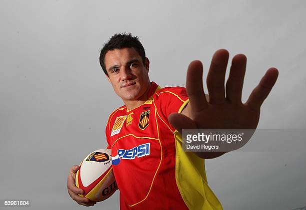 Dan Carter, the New Zealand All Black standoff, wears his new Perpignan shirt during a photoshoot at Canet December 9, 2008 in Perpignan, France.