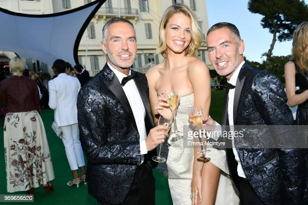 Dan Caten Hailey Clauson and Dean Caten attend the cocktail at the amfAR Gala Cannes 2018 at Hotel du CapEdenRoc on May 17 2018 in Cap d'Antibes...