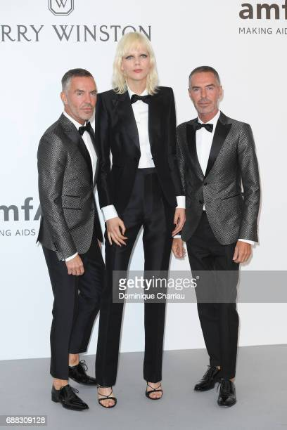 Dan Caten Marjan Jonkman and Dean Caten arrive at the amfAR Gala Cannes 2017 at Hotel du CapEdenRoc on May 25 2017 in Cap d'Antibes France
