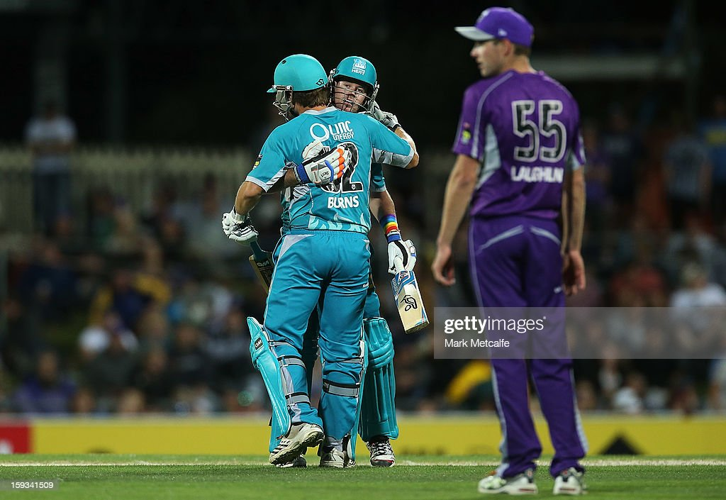 Dan Christian and Joe Burns of the Heat celebrate victory during the Big Bash League match between the Hobart Hurricanes and the Brisbane Heat at Blundstone Arena on January 12, 2013 in Hobart, Australia.