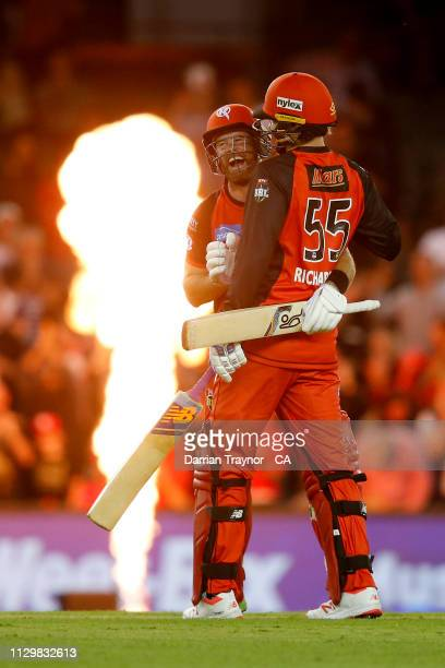 Dan Christian and Kane Richardson of the Renegades celebrate the winning runs during the Big Bash League semi final between the Melbourne Renegades v...
