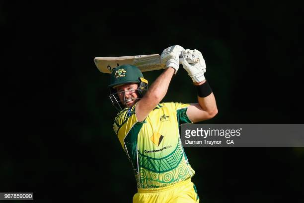 Dan Christian of the Australian Indigenous Men's cricket team hits the winning runs at Arundel cricket ground in the match against the MCC on June 5...