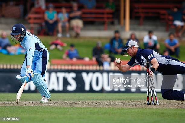 Dan Christian of the Bushrangers attempts to run out Peter Nevill of the Blues during the Matador BBQ's OneDay Cup between New South Wales Blues and...