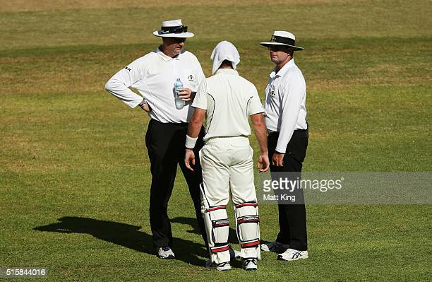 Dan Christian of the Bushrangers talks to the umpires at a drinks break in the last session during day two of the Sheffield Shield match between...