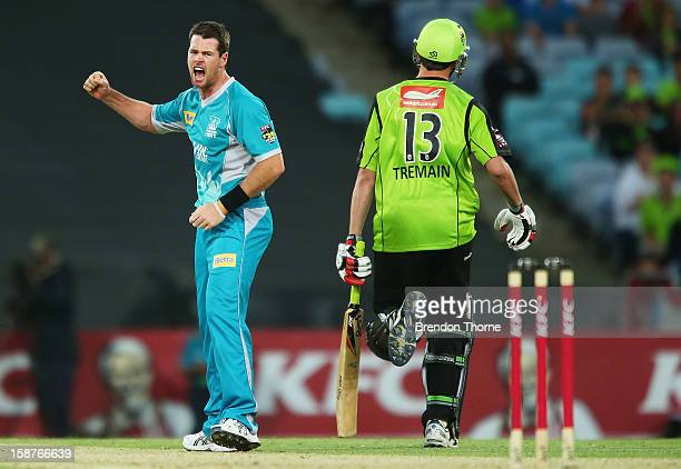Dan Christian of the Heat celebrates after claiming the wicket of Chris Tremain of the Thunder during the Big Bash League match between the Sydney...
