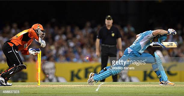 Dan Christian of the Heat is stumped by Tom Triffitt of the Scorchers during the Big Bash League match between the Brisbane Heat and the Perth...