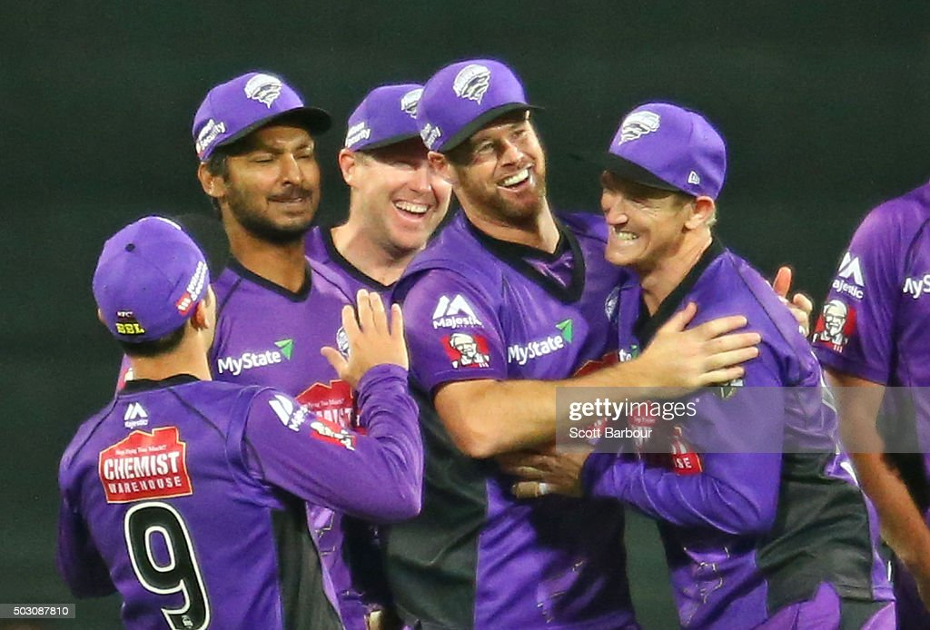 Dan Christian of the Hurricanes celebrates with Kumar Sangakkara and George Bailey after running out Chris Hartley of the Thunder during the Big Bash League match between the Hobart Hurricanes and the Sydney Thunder at Blundstone Arena on January 1, 2016 in Hobart, Australia.