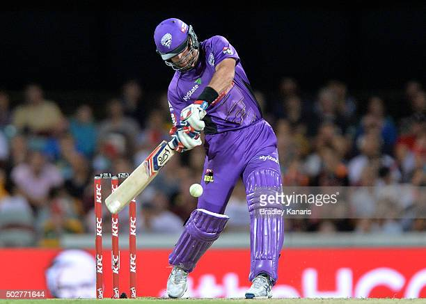 Dan Christian of the Hurricanes hits the ball out of the Gabba Stadium for a six during the Big Bash League match between the Brisbane Heat and...