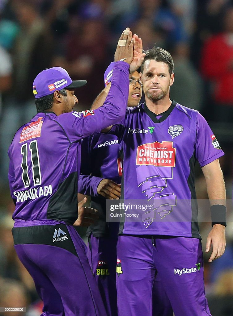 Dan Christian of the Hurricanes is congratulated by team mates after getting the wicket of Lendl Simmons of the Heat during the Big Bash League match between Hobart Hurricanes and Brisbane Heat at Blundstone Arena on December 22, 2015 in Hobart, Australia.