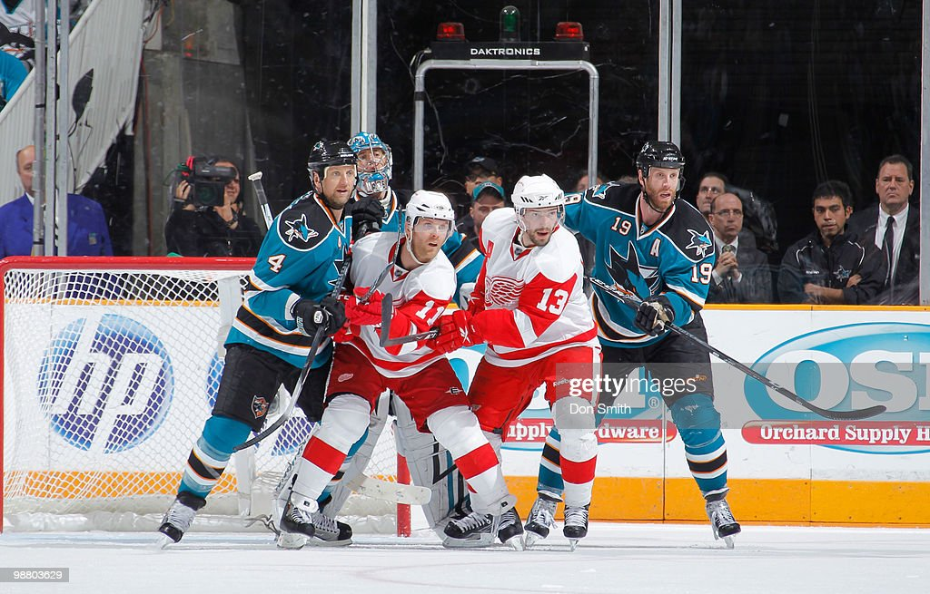 Dan Cleary #11 and Pavel Datsyuk #13 of the Detroit Red Wings stand in front of the net against Joe Thornton #19, Rob Blake #4 and Evgeni Nabokov #20 of the San Jose Sharks in Game Two of the Western Conference Semifinals during the 2010 NHL Stanley Cup Playoffs on May 2, 2010 at HP Pavilion at San Jose in San Jose, California.