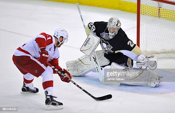 Dan Cleary of the Detroit Red Wings against goaltender MarcAndre Fleury of the Pittsburgh Penguins during Game Six of the NHL Stanley Cup Finals at...