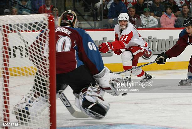 Dan Cleary of the Detroit Red Wings shoots against goaltender Jose Theodore of the Colorado Avalanche during game three of the Western Conference...