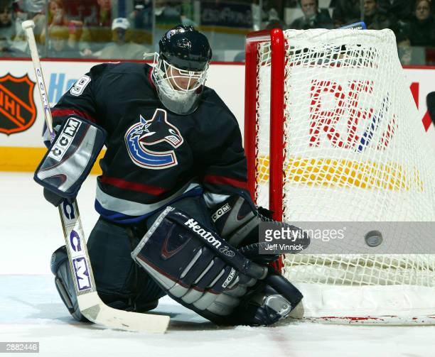 Dan Cloutier of the Vancouver Canucks makes a save during the third period of their game against the Dallas Stars at General Motors Place on January...