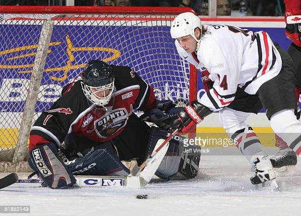 Dan Cloutier of the Vancouver Canucks makes a save off the shot of Ryan Smyth of the Edmonton Oilers during the Brad May and Friends Hockey Challenge...