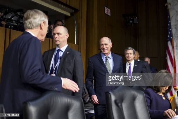 Dan Coats director of national intelligence center and Christopher Wray director of the Federal Bureau of Investigation right arrive to testify...