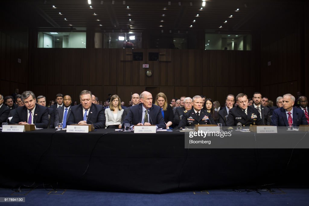 Dan Coats, director of national intelligence, center, testifies during a Senate Intelligence Committee hearing on worldwide threats in Washington, D.C., U.S., on Feb. 13, 2018. From missiles to cyberattacks, the annual intelligence assessment of global threats paints a world where China and Russia seek to upend U.S. influence as allies uncertain of American commitment may turn away from Washington. Photographer: Zach Gibson/Bloomberg via Getty Images